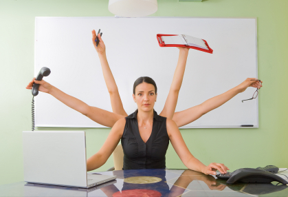 woman seated at her desk doing many tasks with multiple arms