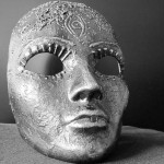 a silver face mask