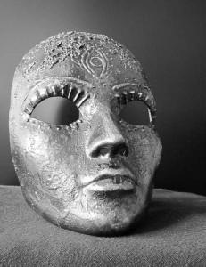 a silver face mask